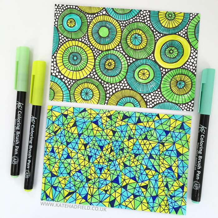 blue and green geometric pattern drawings on index cards