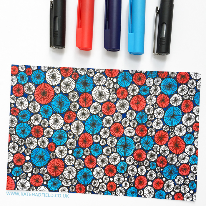 red white and blue geometric pattern drawing on index card