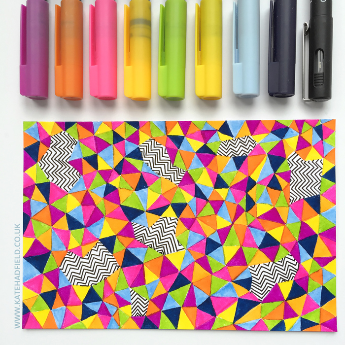colourful geometric pattern drawn on an index card