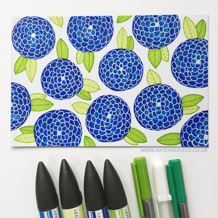 blue and green floral pattern drawing on an index card